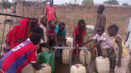 Beneficiaries taking water