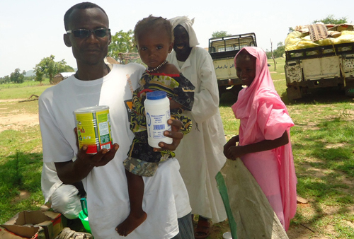 Distribution of food aid to malnourished households, cities of Bindizi/ Um Dukhun